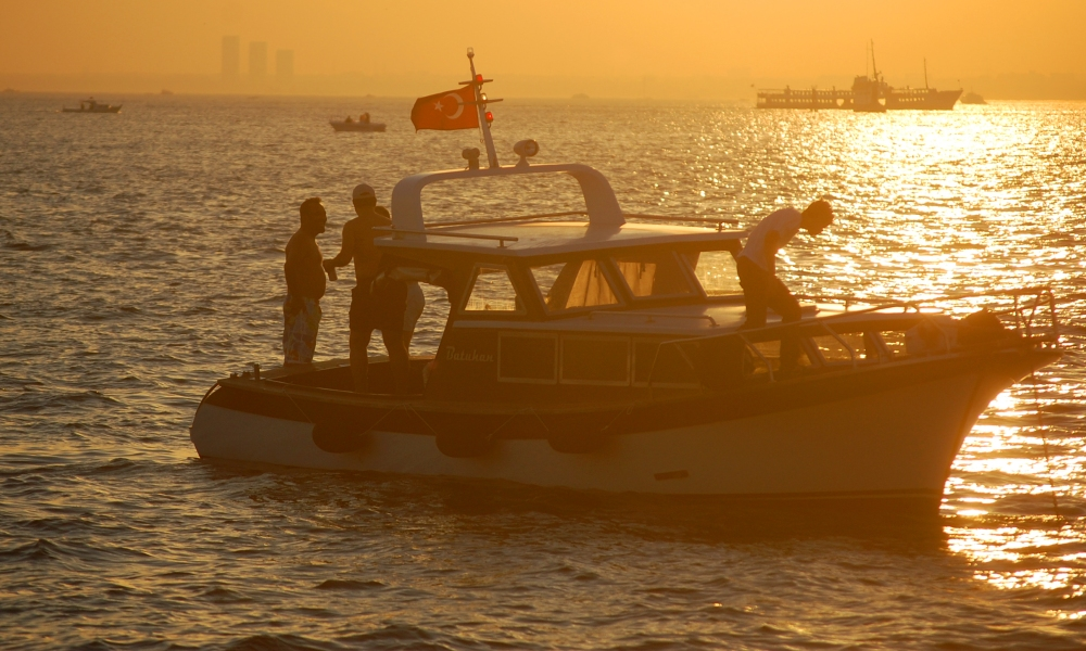 Boat on Bosphorous Strait in Istanbul at Sunset