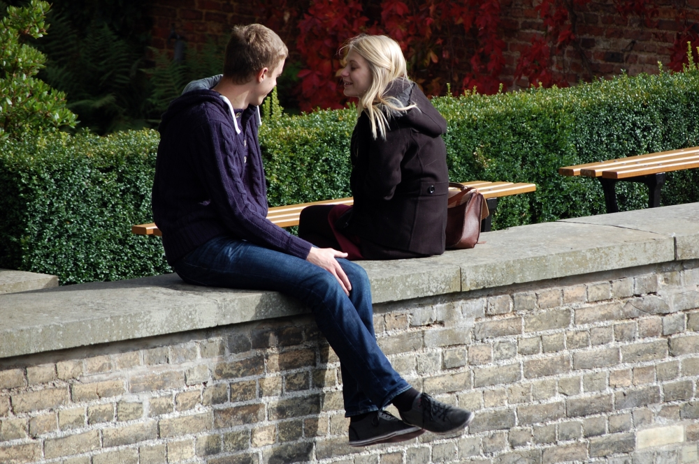 Cambridge Students Sitting on Wall