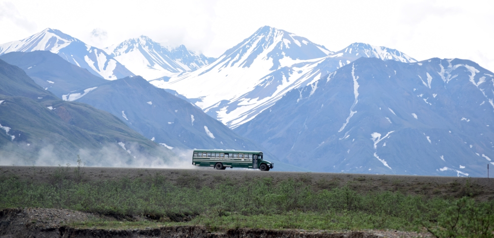 Denali Bus with Dust Trail and Mountains